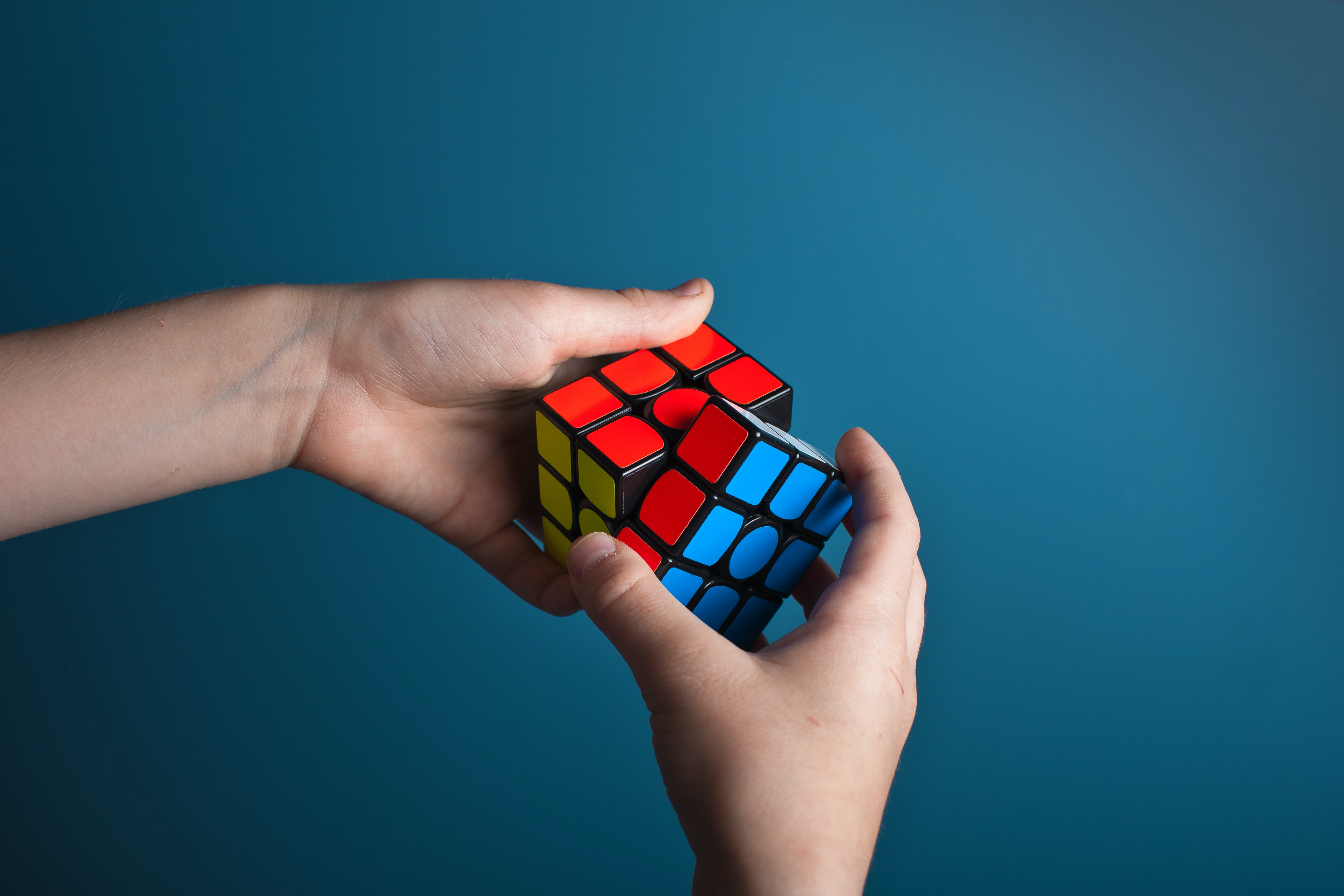 image of solving a Rubik's Cube
